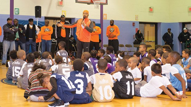 On January 9, 2016, the No Books No Ball male mentor program held its opening day at the Orchard Gardens School. During this event, Tony Richards, Executive Director of NBNB (standing with the microphone) announced its 25th year of operation.
