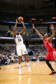 Zach Randolph shoots over Houston's Terrence Jones. (Photo: Joe Murphy/NBAE via Getty Images.)