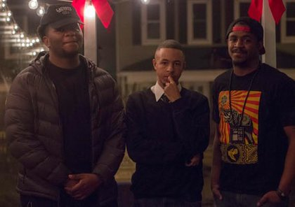 Tino Young, Christian Smooth and Malcolm McFadden share a moment at the first open mic of the year on January 7, 2015 at Metropolitan Kitchen & Lounge, located at 169 West Street in Annapolis.
