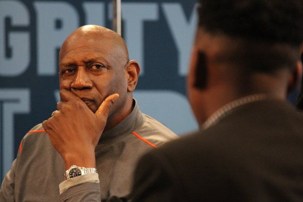 """NBA trailblazer Spencer Haywood listens intently to a student at Grizzlies Prep during a panel discussion on mentoring. """"My Brother's Keeper: Perceptions and Misperceptions of The Urban Youth"""" was part of the Memphis Grizzlies' MLK Weekend activities, which conclude with the annual MLK Day game against the New Orleans Pelicans. (Photo by Lee Eric Smith)"""