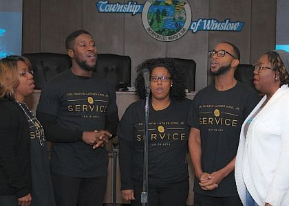 "The Perfecting Church's worship team, Seven Electricity led the crowd in a rendition of ""Lift Every Voice and Sing."""