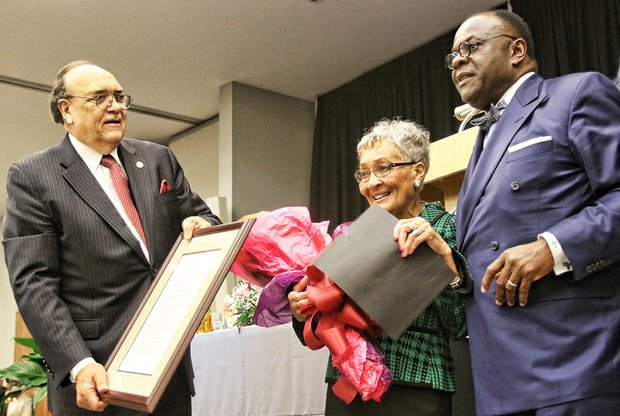 Virginia Union University President Claude G. Perkins, left, and Dr. W. Franklyn Richardson, chairman of the VUU Board of Trustees, present the MLK Lifetime of Service Award to VUU alumna Florence Neal Cooper Smith of Richmond for her work on sickle cell anemia testing and awareness in Virginia and across the nation.