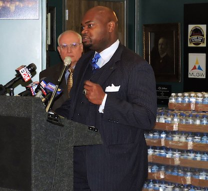 TSD Publisher Bernal E. Smith II announces #Memphis4Flint, a grassroots initiative to donate water and money to residents of Flint. Smith, pictured next to MLGW President Jerry Collins, made the announcement Tuesday morning at MLGW Headquarters, where earlier efforts resulted in FedEx shipping 12,000 bottles of MLGW-bottled water to the troubled city. Photo by Karanja A. Ajanaku.