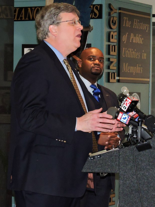 Memphis Mayor Jim Strickland addresses media during a Tuesday news conference while TSD Publisher Bernal E. Smith II looks on. (Photo by Karanja A. Ajanaku)