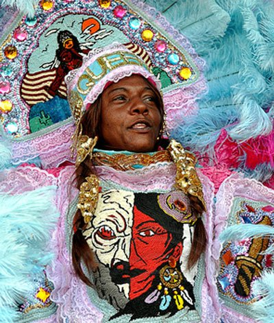 The Mardi Gras Indian Queen's traditional role is to communicate the Chief's directions to the tribe to ensure the group ...