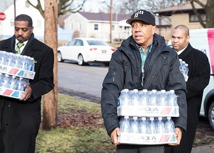 When business mogul and founder of the RushCard, Russell Simmons, arrived in Flint early Monday morning to deliver cases of ...