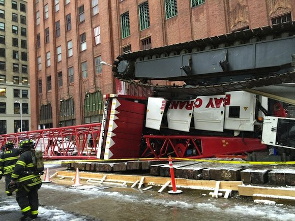 One person was killed and three others injured when a 565-foot crane collapsed during Friday morning's rush hour in snowy ...