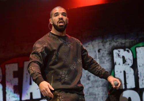 Rapper Drake became the first artist to chart seven simultaneous Billboard Top 10 singles last week, besting the Beatles' record ...
