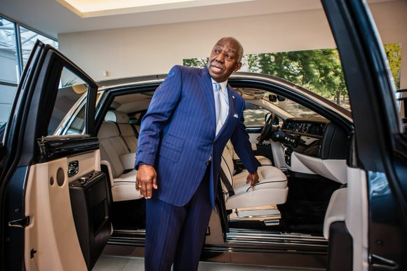 The only thing harder than making a fortune is giving it away wisely, says the world's first black Rolls-Royce dealer.