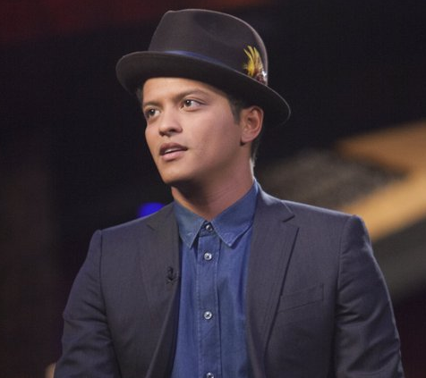 The three big prizes at the 58th Annual Grammy Awards went three different ways Monday night, with Bruno Mars winning ...