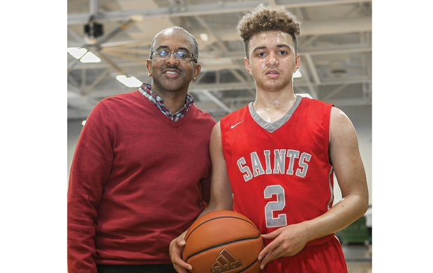 Proud father Eric Thompson Sr. and his talented son, Eric Jr., show the basketball gene runs strongly in their family