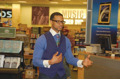 """Portland author and entrepreneur Devin S. James shares his story of trying to bridge the racial divide between officials in Ferguson, Mo. and an enraged black community, during a recent lecture and book signing at the Barnes and Noble in Lloyd Center.  James is the author of """"Inside Ferguson"""" A Voice for the Voiceless,"""" a walk-though of what happened after the 2014 death of Michael Brown."""
