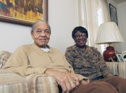 William and Ora Lomax, relax at home as they prepare to launch a combination barber-beauty shop on South Side.