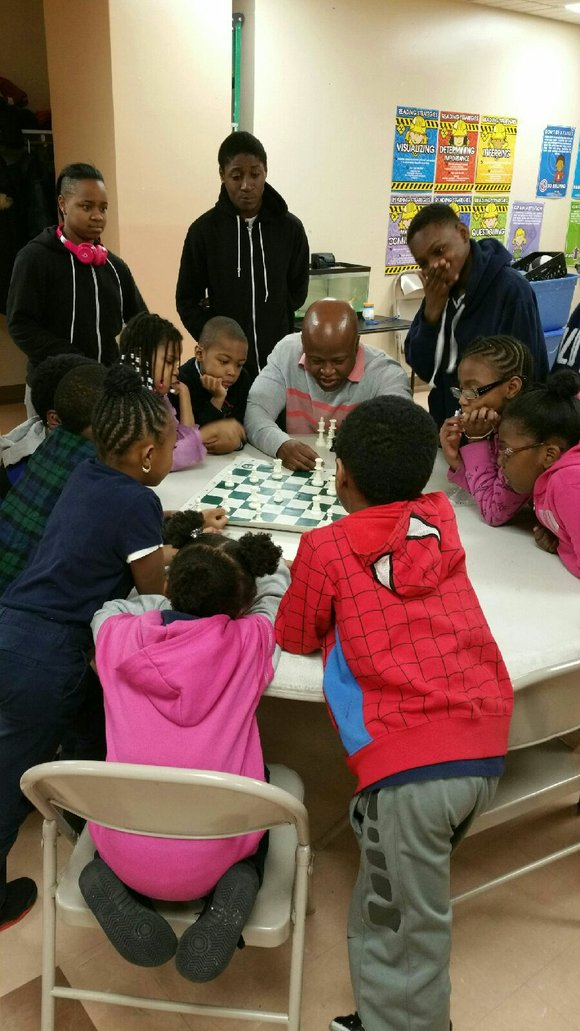 Maurice Ashley, the First International African American Chess grandmaster, returned to Brownsville to share his skills in a chess workshop.