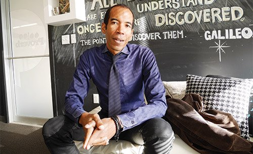 Proverb founder Daren Bascome sits at the design agency's office in Boston's South End.