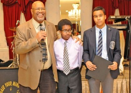 Ricardo Taylor, mayor of Pennsauken and Chairman of the Black Catholic Scholarship Committee with last year's scholarship winners. Stephen Malloy, 15, of Paul VI High School in Haddonfield and Myles Holder,15, a freshmen at St. Augustine High School in Richland.