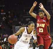 CIAA Tournament Most Valuable Player Kiana Johnson of Virginia Union University dribbles past a Shaw University player in the title game Saturday.