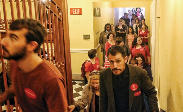 "Members of the impromptu ""Keep Ken Out"" movement line the hallway and steps leading to the Virginia Senate gallery. Wearing stickers, like the one above, they came to the State Capitol to protest a Republican plan to seat Ken Cuccinelli on the Virginia Supreme Court. The protest and plan ended when he declined the position."