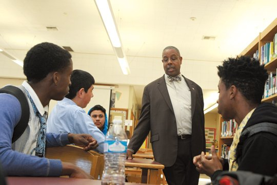 Principal Douglas Brown talks to his students about the importance of dressing professionally./OW Photo by Jason Lewis