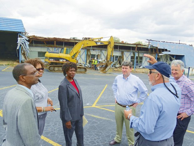 Granite Crossing construction manager Gary Brink explains project timeline to Mayor Deborah Jackson and council members  Diane Howard and Fred Reynolds as demolition begins on old city hall building. With him, Wendover Partners' Bryan Hartnett and engineer Roger Register.