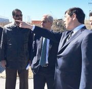 Michael Bashaw, Whole Foods Midwest regional president (right), points out the site for a new Pullman distribution center to Mayor Rahm Emanuel (center) and Alderman Anthony Beale (Ward-9th).
