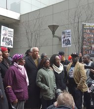 Assemblyman Charles Barron stands with the family and supporters of Akai Gurley