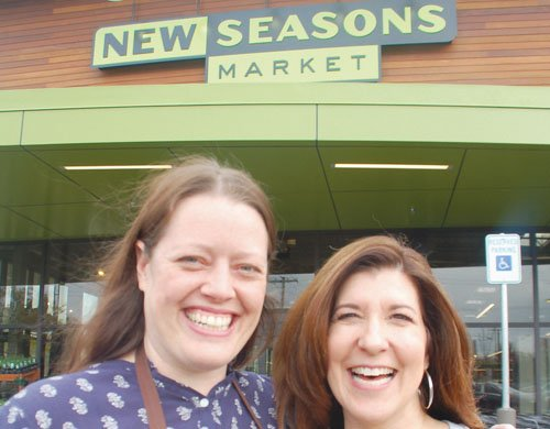 A community welcome goes out at the grand opening of the New Seasons Market on North Lombard Street in the University Park neighborhood from Erin Leiker (left) manager of the store and Wendy Collie, New Seasons' chief executive officer.