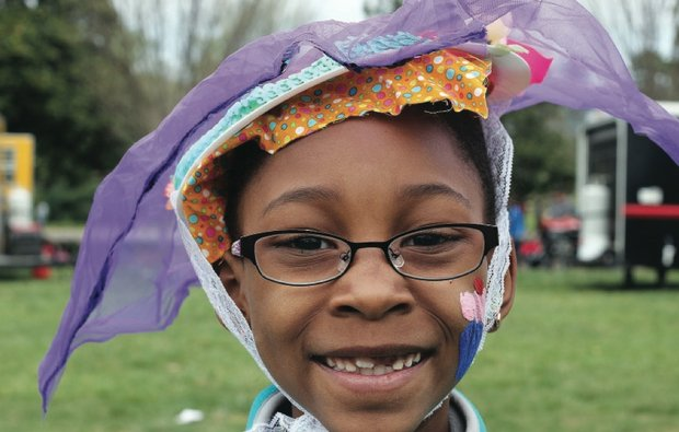 Easter events in the city //Destini Spain shows off the colorful bonnet she crafted alongside scores of other youngsters.