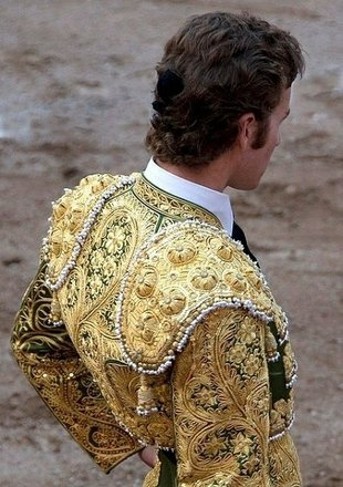 Men wear shrugs too…especially when they're employed as Matadors (bullfighters).