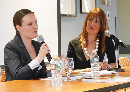 """Ana Muñoz (l), researcher at the Federal Reserve Bank of Boston, discusses findings from """"The Color of Wealth in Boston"""" with Dharma E. Cortéz at the Latinas Think Big summit April 12."""