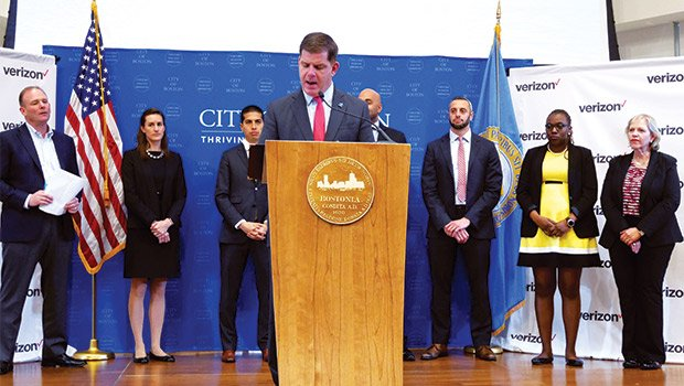 Mayor Martin Walsh, flanked by Verizon representatives and City of Boston officials, announces a partnership with Verizon to bring a high-speed fiber-optic network to Boston.