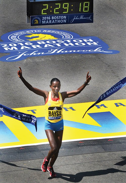 Atsede Baysa wins in the Women's Elite Division during the Boston Marathon. Baysa took the lead at Mile 21 and surged all the way to the finish.