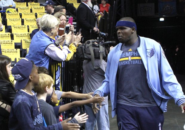 Zach Randolph has a low-fives greeting for revved up fans as he made his entry onto the FedExForum court. The crowd delivered NBA Playoffs-level support throughout the evening. (Photo: Warren Roseborough)