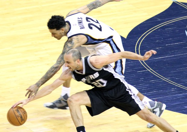Matt Barnes, who was a force throughout the game, battles for possession with San Antonio's Manu Ginobilli. (Photo: Warren Roseborough)