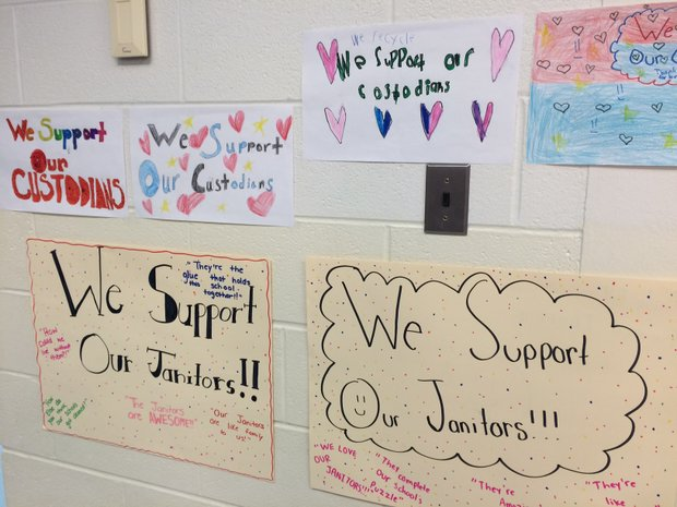 Students at Charles Reed Elementary show their support for the janitorial staff who face outsourcing by the district.