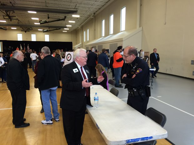 Will County Executive Larry Walsh talks with Romeoville Police Chief Mark Turvey at the Hero-Helps Soutwest Coaltion Community Summit in Romeoville last week.
