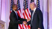 Former Republican presidential candidate Ben Carson shakes hands with Donald Trump as he endorses the Republican front-runner at the Mar-a-Lago Club in Palm Beach, Fla., on March 11, 2016. JOE RAEDLE/GETTY IMAGES