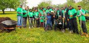 Volunteers cleaned up trash and debris, trimmed trees, placed mulch around trees and painted garbage cans at Carroll Park in Baltimore during the 15th annual Comcast Cares Day on Friday, April 29, 2016