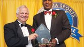 Retired NBA star Charles Oakley is presented with an award last Saturday during his induction into the Virginia Sports Hall of Fame in Portsmouth by Joel Rubin, chairman of the Hall of Fame board.