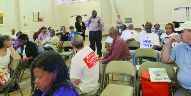 Residents ask questions at a candidate forum.