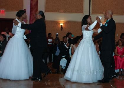"""2016 Debutantes Autumn Janee' Harrison and Samantha Lisa Wood with their fathers during the Debutantes and Fathers' Waltz to the song """"Daughters"""" by John Mayer."""