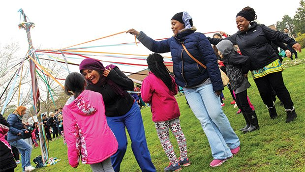 Members of BalletRox kick off the Wake Up The Earth festival with a dance around a maypole. The annual Jamaica Plain festival brings performances, vendors and political activists to the Southwest Corridor Park.