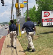 Officers Barbara Lorena and Torrance Armstrong visited properties along Candler Road on May 12.