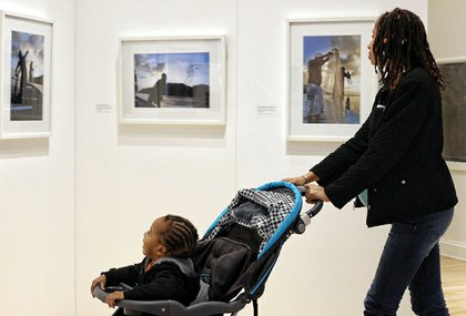 Shenelle Reed strolled with her year- old son, Ka'Leel, who was engrossed in the portraits of Yemaya by Arturo Lindsay