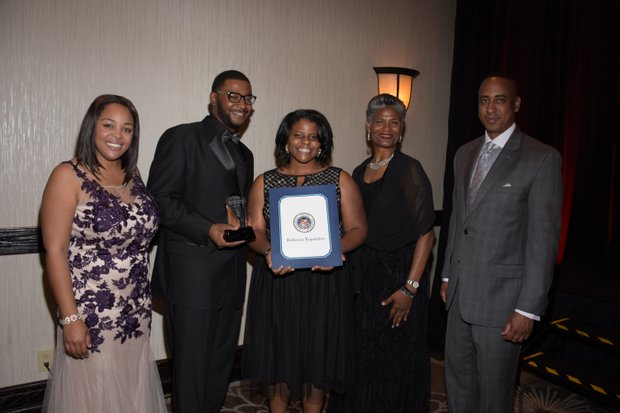 "(L-R) Ta Lese Morrow, Co-Publisher (IVN); Antoine & Heather Dunham, Honorees (We Speak- The ""Arts"" of Words and Literacy; Carolyn Tillman , 2015 COE Honoree (Educational Administration); Michael Lacy (PAB Chair)"
