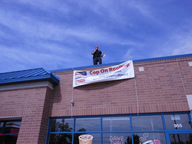 Shorewood police commanger Eric Allen takes part in the Cop on Rooftop event in a photo from the 2013 event.