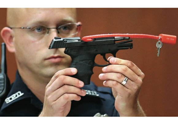 Online bidding for the gun used by George Zimmerman to kill unarmed black teenager Trayvon Martin in Sanford, Fla., in ...