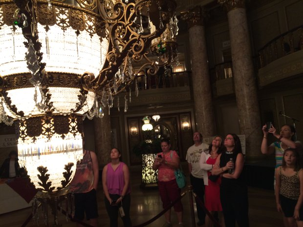 "Visitors get an up close and personal look at ""The Duchess"" the 2.5 ton chandelier that was lowered in the lobby for the 90th anniversary gala."