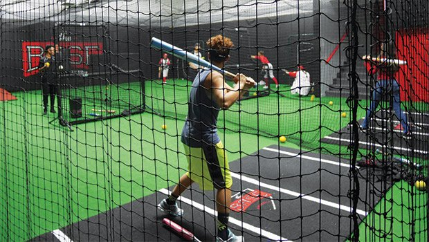 Batter up during girls' softball practice at The BASE. The Roxbury-based nonprofit will soon begin offering girls' baseball.