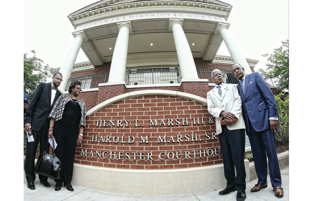 From left, Harold M. Marsh Jr. and Dr. Erica Marsh, the children of Harold M. Marsh Sr.; Henry L. Marsh III; and Richmond Mayor Dwight C. Jones stand in front of the new sign outside the courthouse at 920 Hull St. The South Richmond courthouse was renamed last Friday in honor of Mr. Marsh and his brother, Harold M. Marsh Sr., who died in 1997.